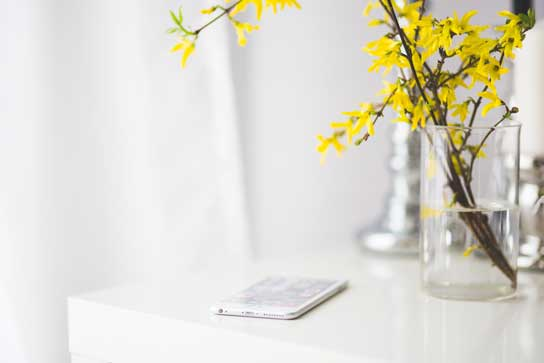 Iphone on table with flowers